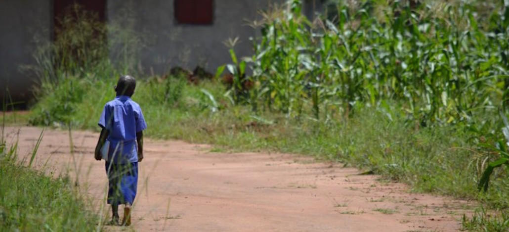 A girl in northern Uganda returns to school after lunch.