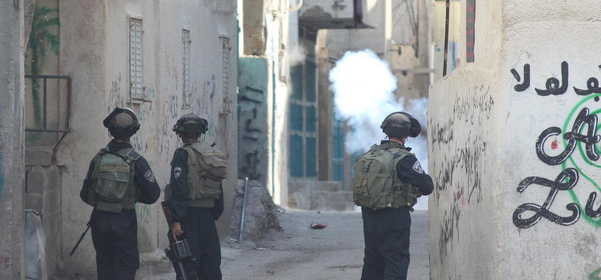 Israeli soldiers fire tear gas in Aida refugee camp in 2014.
