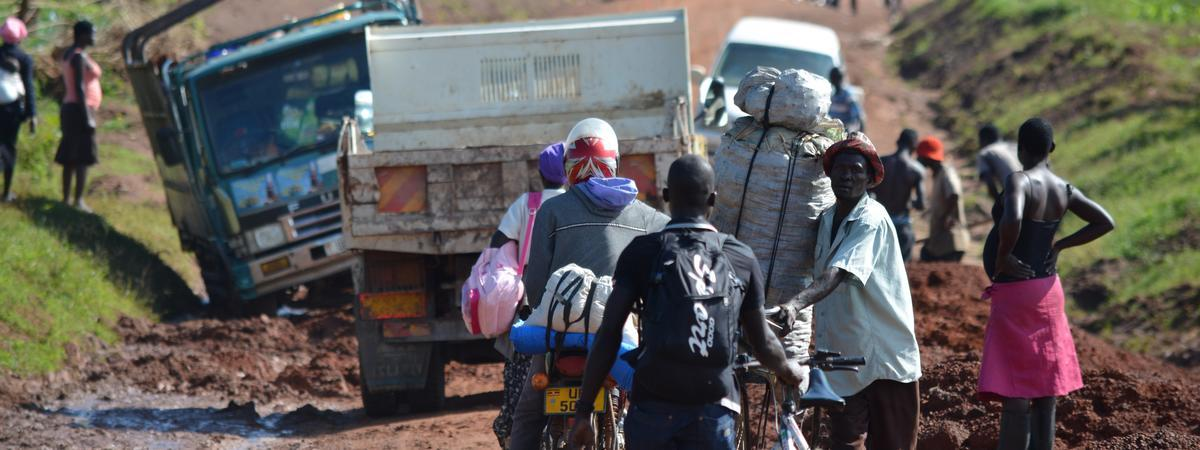 People stuck in one of the many difficult and challenging roads in Uganda
